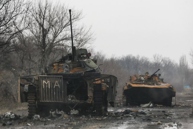 Armoured vehicles, destroyed during battles between the armed forces of the separatist self-proclaimed Donetsk People's Republic and the Ukrainian armed forces, are seen in Vuhlehirsk February 6, 2015. (Photo by Maxim Shemetov/Reuters)