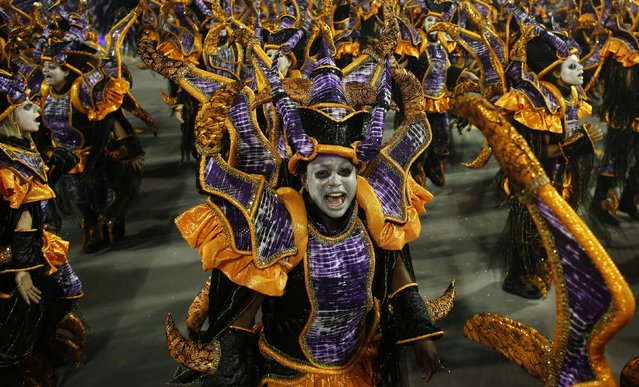 Revellers from the Rosas de Ouro Samba School take part in a carnival at Anhembi Sambadrome in Sao Paulo February 14, 2015. (Photo by Nacho Doce/Reuters)