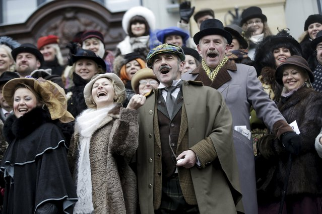 "People dress up as characters from Scottish writer Arthur Conan Doyle's stories as they celebrate the birthday of detective Sherlock Holmes, one of Doyle's most famous fictional character, in Riga, Latvia, January 9, 2016. From 1979 to 1986, a Soviet TV film adaptation of the novel titled ""The Adventures of Sherlock Holmes and Doctor Watson"" shot most of its episodes in Riga. (Photo by Ints Kalnins/Reuters)"
