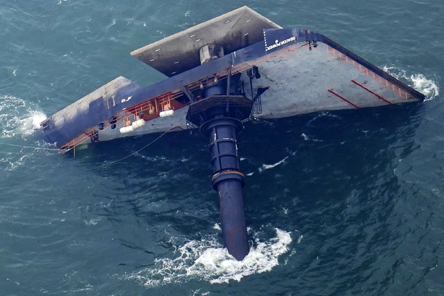 The capsized lift boat Seacor Power is seen seven miles off the coast of Louisiana in the Gulf of Mexico Sunday, April 18, 2021. The vessel capsized during a storm on Tuesday. (Photo by Gerald Herbert/AP Photo)