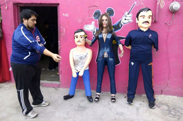 """Pinatas depicting the Mexican actress Kate del Castillo and the drug lord Joaquin """"El Chapo"""" Guzman are displayed outside a workshop in Reynosa, in Tamaulipas state, Mexico, January 13, 2016. (Photo by Xinhua/Barcroft Media)"""