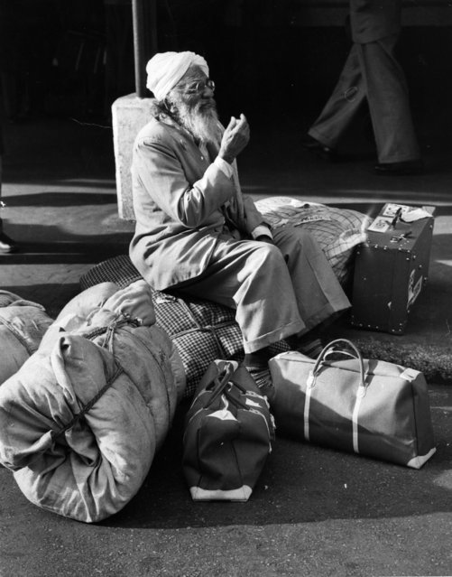 The end of a journey from India. One of the thirty seven Indians detained on board a boat at Dover is allowed to enter Britain, 21st November 1959. Here he sits at Victoria Station. (Photo by Hulton Archive/Getty Images)
