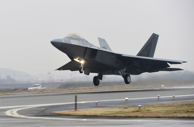 A U.S. Air Force F-22 Raptor takes off from a South Korean air base in Gwangju, South Korea, Monday, December 4, 2017. The United States and South Korea have started their biggest-ever joint air force exercise with hundreds of aircrafts including two dozen stealth jets. (Photo by Yonhap via AP Photo)