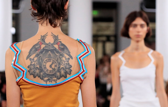 A model with a tattoo on her back presents a creation by designer Glenn Martens as part of his Spring/Summer 2019 women's ready-to-wear collection show for Y/Project during Paris Fashion Week in Paris, France, September 27, 2018. (Photo by Gonzalo Fuentes/Reuters)