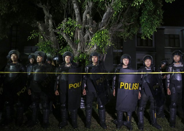 Indonesia policemen stand guard in front of Kerobokan prison before two Australian death row prisoners, Myuran Sukumaran and Andrew Chan, leave prison for the airport, in Denpasar, on the Indonesian island of Bali, March 4, 2015