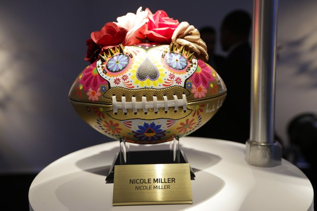 A Nicole Miller designed football is displayed at the unveiling of the CFDA Footballs Wednesday, January 20, 2016, at the NFL headquarters in New York. In celebration of Super Bowl 50 and in support of the NFL Foundation, the NFL and the Council of Fashion Designers of America have collaborated on 50 Bespoke Designer Footballs created by CFDA Members. (Photo by Frank Franklin II/AP Photo)