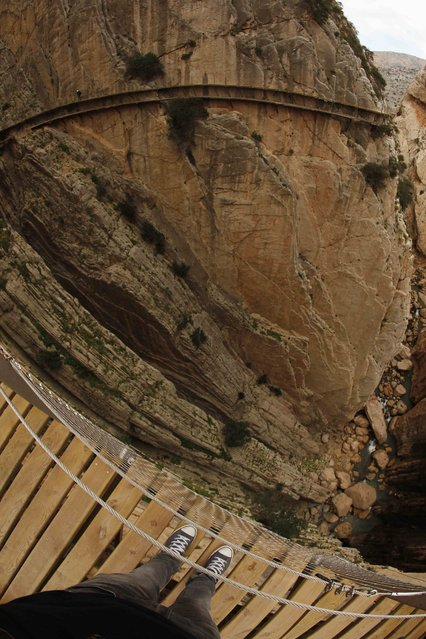 A journalist (top) walks along the new Caminito del Rey (The King's Little Pathway) in El Chorro-Alora, near Malaga, southern Spain March 15, 2015. (Photo by Jon Nazca/Reuters)