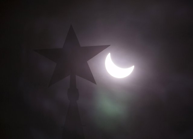 A star on the top of the tower of the Kremlin is seen during a partial solar eclipse in central Moscow, March 20, 2015. (Photo by Tatyana Makeyeva/Reuters)