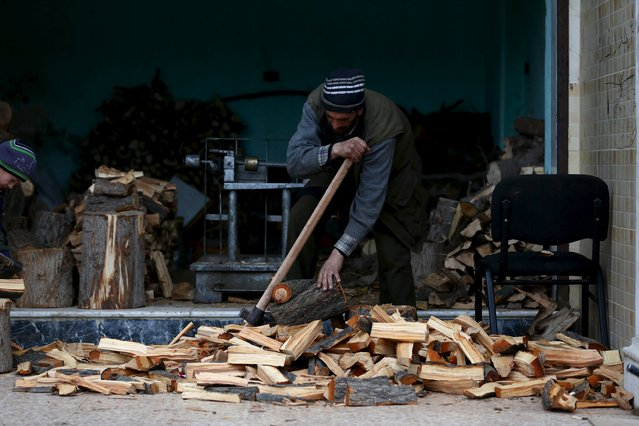 A man prepares firewood in the town of Douma, eastern Ghouta in Damascus, Syria January 5, 2016. Picture taken January 5, 2016. (Photo by Bassam Khabieh/Reuters)