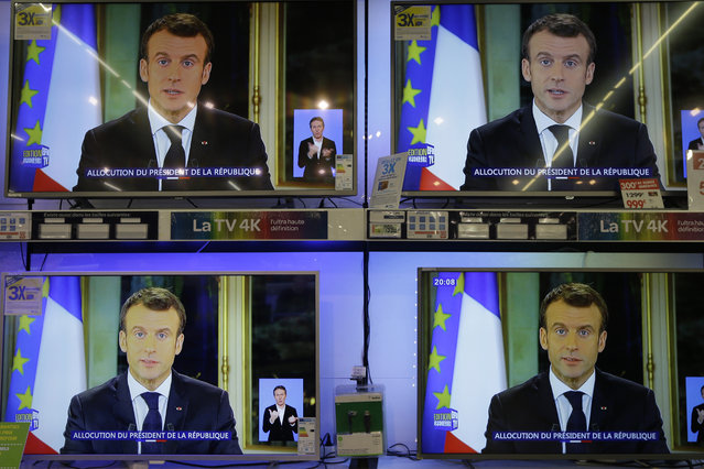 TV screens show French President Emmanuel during a televised address to the nation, at an electrical appliance store in Marseille, southern France, Monday, December 10, 2018. President Emmanuel Macron has acknowledged he's partially responsible for the anger that has fueled weeks of protests in France, an unusual admission for the leader elected last year. (Photo by Claude Paris/AP Photo)
