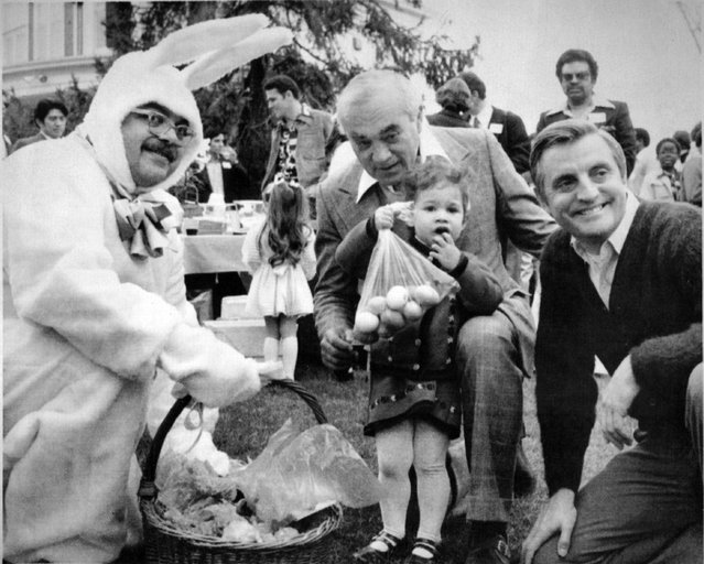 April 10, 1977, Big Bunny: Vice President Walter Mondale is pictured right, with television newsman Martin Agronsky and his daughter Rachel as they gather round the Easter bunny on the grounds of the vice presidential residence in Washington Sunday, The bunny, who was the center of attention at the party hosted by Mondale for youngsters, is played by Mike Berman, the vice president's counsel. (Photo by AP Wirephoto)