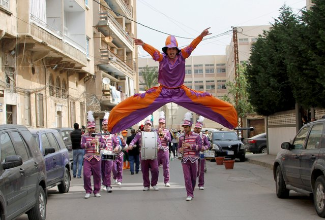 A dancer jumps during a parade celebrating the coming of spring in Tripoli, north Lebanon April 17, 2015. (Photo by Omar Ibrahim/Reuters)