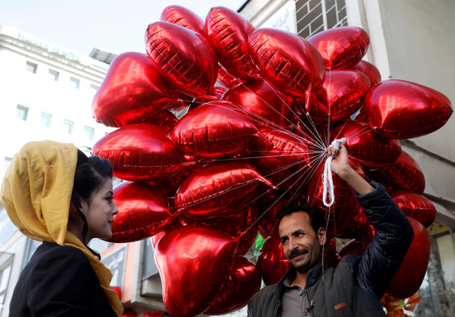 People celebrate Valentine's Day in Kabul, Afghanistan on February 14, 2019. (Photo by Omar Sobhani/Reuters)