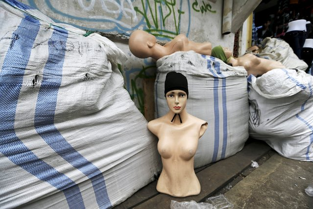 Abandoned manequins belonging to a hijab vendor are left on a street after Civil Service policemen conducted a sweep operation against illegal steet vendors causing traffic congestion at Tanah Abang market in Jakarta, April 7, 2015. (Photo by Reuters/Beawiharta)