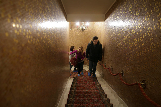 A tour guide leads the way for two Russian tourists during their visit at Romania's former communist dictator Nicolae Ceausescu' villa in Bucharest, Romania January 25, 2017. (Photo by Octav Ganea/Reuters/Inquam Photos)