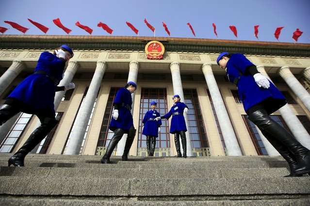 Hotel guides prepare for pictures outside the Great Hall of the People during the opening session of the National People's Congress (NPC) in Beijing, China, March 5, 2016. (Photo by Aly Song/Reuters)