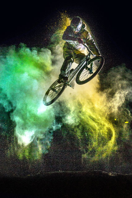These snaps show a pair of daredevil bikers performing gravity-defying stunts as they get covered from head to toe in brightly colored powder. The stunning action shots show the fearless duo perform nail-biting tricks on their BMX bikes as they get showered with the brilliantly colored powder. (Photo by Christoph Jorda/Caters News)