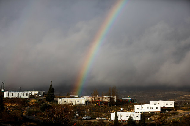 A rainbow is seen over the Israeli settler outpost of Amona in the occupied West Bank January 31, 2017. (Photo by Ronen Zvulun/Reuters)