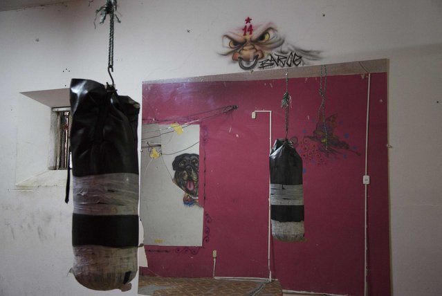 This April 14, 2015 photo shows a punching bag hanging inside the gym, also reflected in a mirror, at the now empty Garcia Moreno Prison, during a guided tour for the public in Quito, Ecuador. Prisoner access to the gym was considered a privilege. (Photo by Dolores Ochoa/AP Photo)