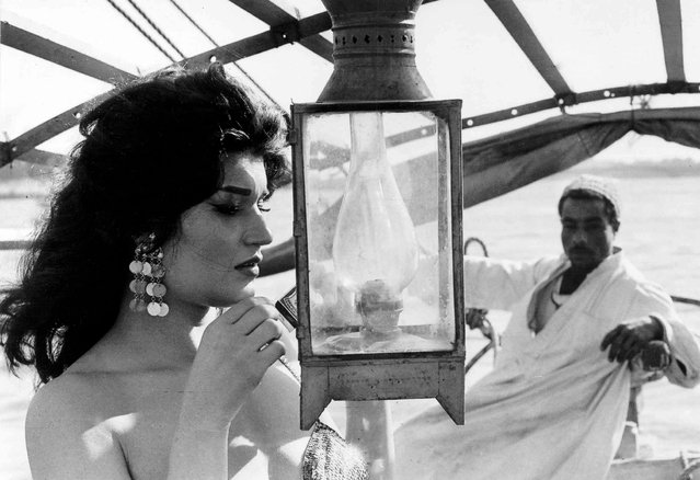 Belly dancer Nagwa Fouad sailing on the river Nile, 1972. Farouk Ibrahim was a society photographer, capturing Egyptian's political and cultural elite, including presidents Nasser, Sadat and Mubarak. (Photo by Farouk Ibrahim)
