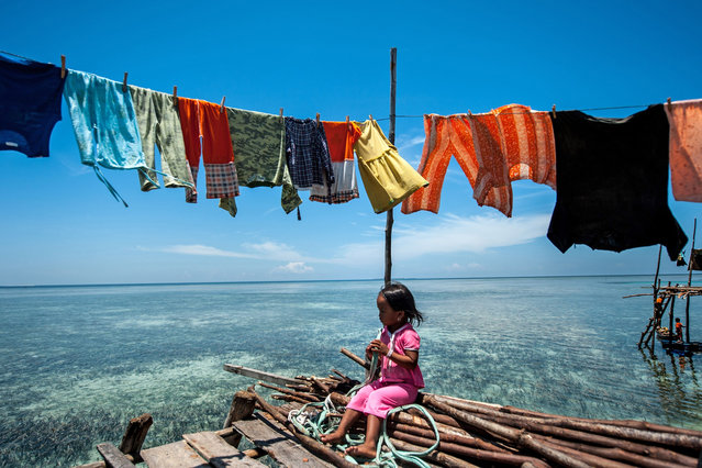 The Bajau people of Malaysia live their lives completely at sea, living in wooden huts and spending their days fishing. Sailing over crystal clear waters, the Bajau people of Malaysia live their lives almost entirely at sea. Children as young as four catch fish, octopus and lobsters from handmade boats off the eastern coast of Sabah, Malaysia. (Photo by Ng Choo Kia/Hotspot Media/SIPA Press)