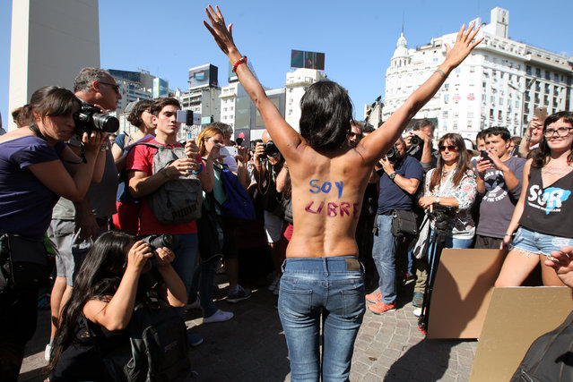 Women stage a topless protest in Buenos Aires, Argentina on February 7, 2017. Activists take to streets of downtown after three women had been topless sunbathing on Necochea, near Buenos Aires, when they were approached by officers that told to cover their breasts. The sunbathers and officers argue, with the girls insisting going topless is not illegal, but the police insist they are offending the local culture. This protest is in support of the three women of Necochea. (Photo by Claudio Santisteban/ZUMA Wire/Rex Features/Shutterstock)