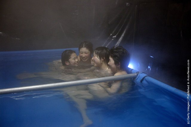 Japanese earthquake victims enjoy a communal bath set up in tents by the Japanese Self Defense Force