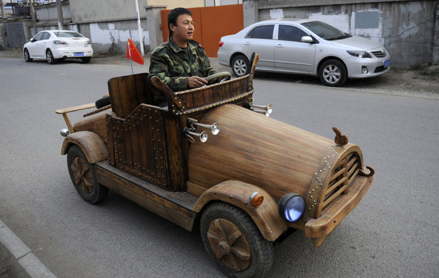 Liu Fulong tests his homemade wooden electronic vehicle in Shenyang, Liaoning province, October 30, 2014. (Photo by Reuters/China Daily)