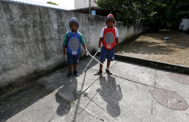 """Children from municipal school Parana pose for a photograph during the project """"Fencing School"""" in Rio de Janeiro, Brazil, March 30, 2016. (Photo by Sergio Moraes/Reuters)"""