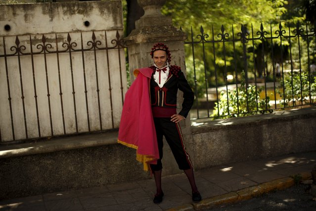 "Jose Luis del Valle, 32, dressed as a bullfighter from the era of 18th century painter Francisco Goya, poses for a photo as he participates in the third edition of ""Ronda Romantica"" (Romantic Ronda) in Ronda, southern Spain, May 16, 2015. (Photo by Jon Nazca/Reuters)"