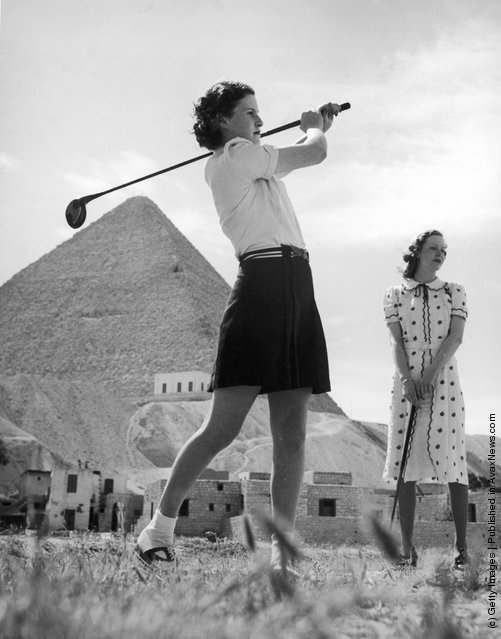 An English tourist drives off at the new Mena House Golf Course, situated almost at the foot of the Great Pyramid at Giza, near Cairo, Egypt, 1938