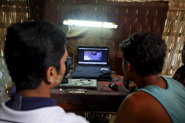 Rohingya Muslims watch Rohingya news at an Internet shop in a refugee camp outside Sittwe, Myanmar May 21, 2015. Picture taken May 21, 2015. (Photo by Soe Zeya Tun/Reuters)