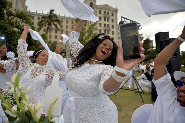 "Guests in white costumes attend the ""Diner en Blanc"" event, at the Hotel Nacional in Havana, Cuba on April 6, 2019. (Photo by Yamil Lage/AFP Photo)"