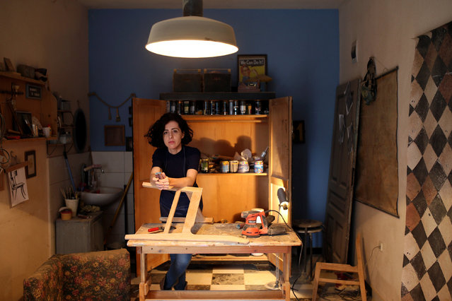 """Lejla Selimovic, 34, a furniture restorer, poses for a photograph at her workshop Wood Surgery in Zenica, Bosnia and Herzegovina, February 24, 2017. """"In my country this is an unusual profession for a woman, but so far I have not met anyone seeing it in a negative context. People are often surprised, but essentially only interested in a job well done"""", she said. (Photo by Dado Ruvic/Reuters)"""