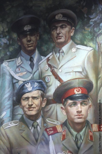 A painting detail shows soldiers wearing uniforms of Cold War-era Warsaw Pact-member