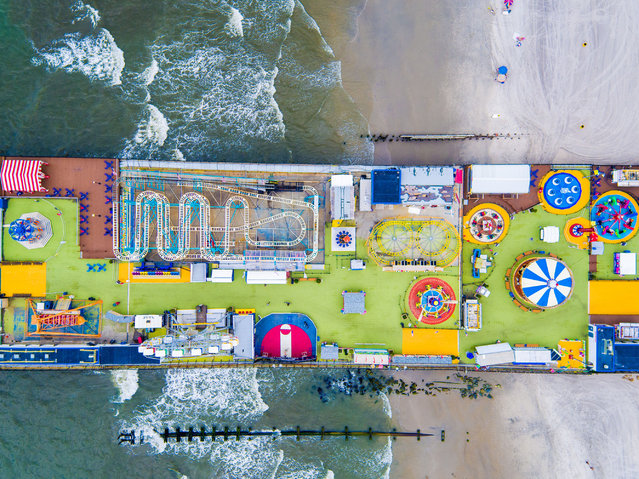 Orginally the Showplace of the Nation, the 1,000-foot-long Steel Pier was once the crown jewel of northeastern entertainment venues. (Photo by Chase Guttman/Caters News)