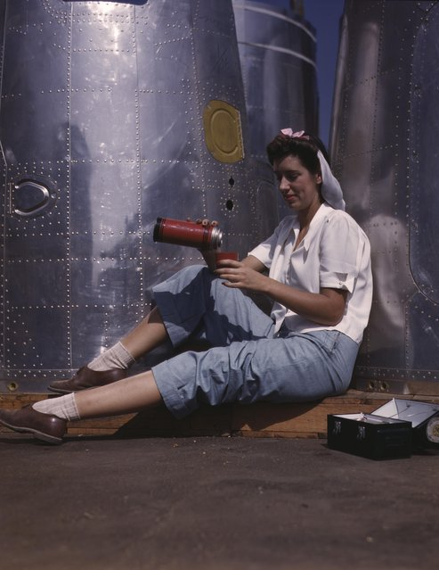 Girl worker at lunch also absorbing California sunshine, Douglas Aircraft Company, Long Beach, California, 1942. (Photo by Alfred T. Palmer/Buyenlarge/Getty Images)