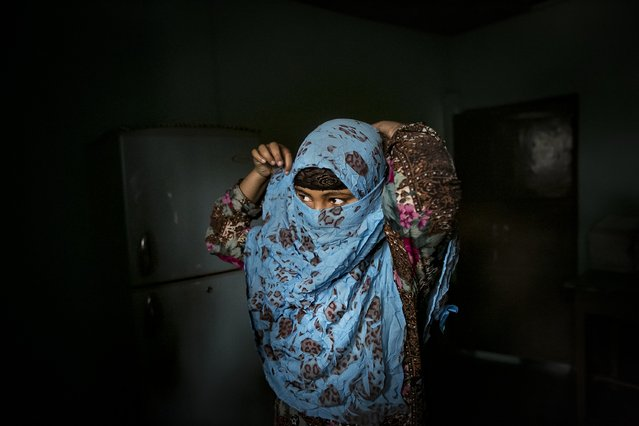 Rani ties her scarf around her face before leaving her home to take a school exam March 6, 2017 in Khulna division, Bangladesh. (Photo by Allison Joyce/Getty Images)