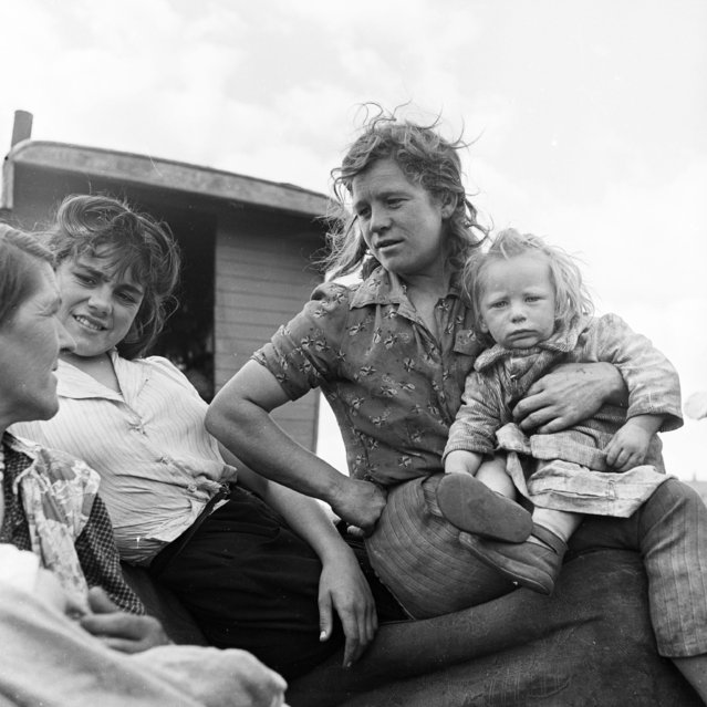 A Romany family on the steps of their caravan at the Corke's Meadow encampment in Kent, 28th July 1951. (Photo by Bert Hardy/Picture Post/Getty Images)