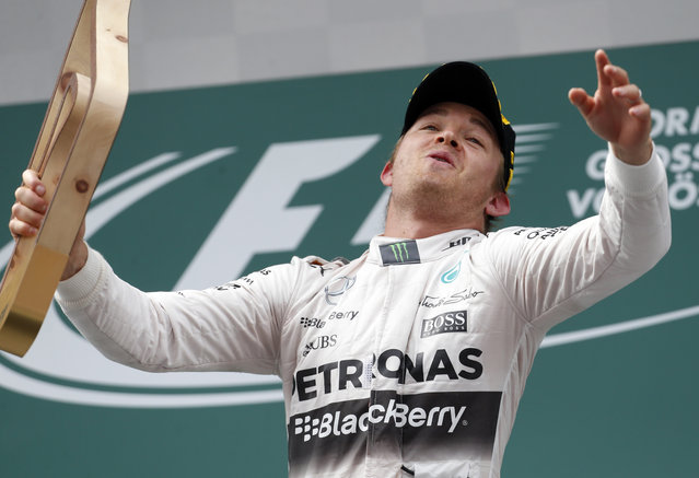 Mercedes driver Nico Rosberg of Germany celebrates his victory in the Formula One Grand Prix race, at the Red Bull Ring in Spielberg, southern Austria, Sunday, June 21, 2015. (AP Photo/Darko Bandic)