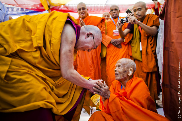 His Holiness, the Dalai Lama greets an elderly Buddhist monk at a multi-faith prayer gathering at Gandhi Smriti prior to his keynote speech at the Global Buddhist Congregation on November 30, 2011 in New Delhi, India. The Dalai Lama is attending the four day Global Buddhist Congregation, which will be attended by religious leaders from 32 countries. The aim of the Congregation is to set up an international forum that will aim to promote global peace, stability and prosperity through collective action, while rejecting prejudices, exploitation and violence