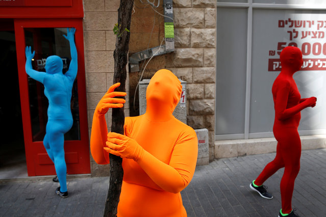 Members of the Prizma Ensemble wearing full solid-coloured bodysuits take part in the 6th Jane's walk Jerusalem in Jerusalem Israel May 6, 2016. (Photo by Baz Ratner/Reuters)
