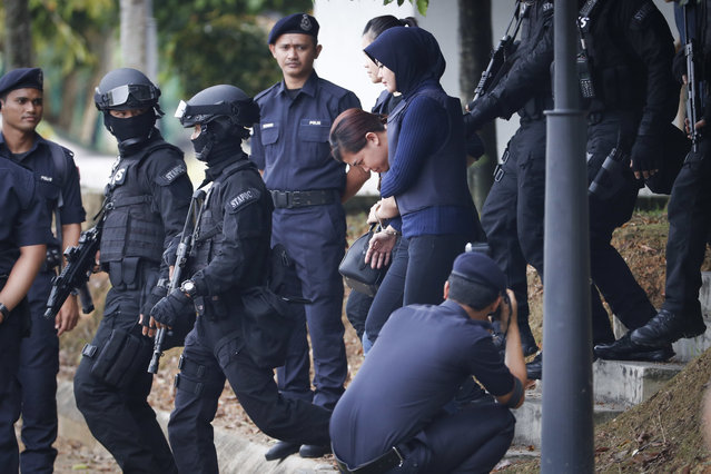 Indonesian suspect Siti Aisyah, center, arrested in the death of Kim Jong Nam, is escorted by police officers as she leaves a court house in Sepang, Malaysia, Thursday, April 13, 2017. Malaysian authorities said two women swiped Kim's face with VX nerve agent as he waited in Kuala Lumpur airport for a flight home to Macau in February. (Photo by Vincent Thian/AP Photo)
