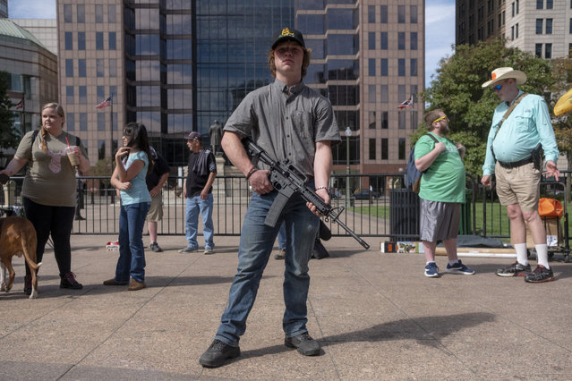 A person exercises their right to open carry a firearm as gun owners and second amendment advocates gather at the Ohio State House to protest gun control legislation on September 14, 2019 in Columbus, Ohio. The group stood against red flag laws proposed by Ohio Governor Mike DeWine and national politicians in the wake of a wave of mass shootings throughout the U.S. (Photo by Matthew Hatcher/Getty Images)