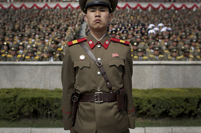 A soldier stands guard at the Kim Il Sung Square during a military parade Saturday, April 15, 2017, in Pyongyang, North Korea, to celebrate the 105th birth anniversary of Kim Il Sung, the country's late founder and grandfather of current ruler Kim Jong Un. (Photo by Wong Maye-E/AP Photo)