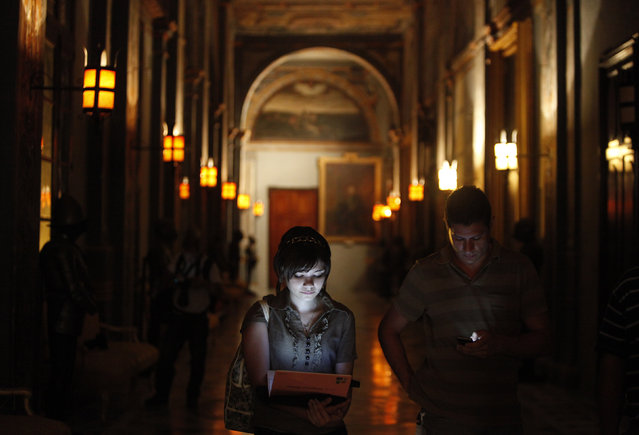 Journalists look at their laptops and mobile phones while waiting for a news conference by Malta's Prime Minister Lawrence Gonzi (not pictured) at parliament within the 16th century Grandmaster's Palace in Valletta late June 18, 2012. (Photo by Darrin Zammit Lupi/Reuters)