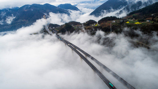Photo taken on April 4, 2017 shows the cloud-wrapped Siduhe Bridge in Enshi, central China's Hubei Province. (Photo by Wen Lin/Xinhua/Barcroft Images)