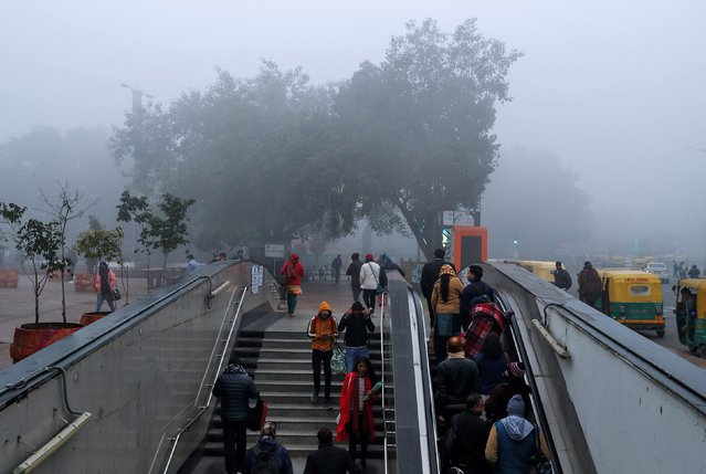 Commuters at a metro station on a foggy morning in New Delhi, India, December 30, 2019. (Photo by Danish Siddiqui/Reuters)