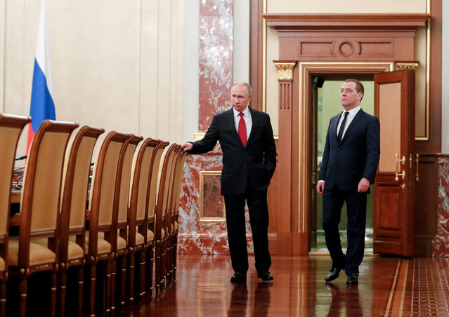Russian President Vladimir Putin, right, and Russian Prime Minister Dmitry Medvedev talk to each other prior to a cabinet meeting in Moscow, Russia, Wednesday, January 15, 2020. The Tass news agency reports Wednesday that Russian Prime Minister Dmitry Medvedev submitted his resignation to President Vladimir Putin. Russian news agencies said Putin thanked Medvedev for his service but noted that the prime minister's Cabinet failed to fulfill all the objectives set for it. (Photo by Dmitry Astakhov/Sputnik/Government Pool Photo via AP Photo)