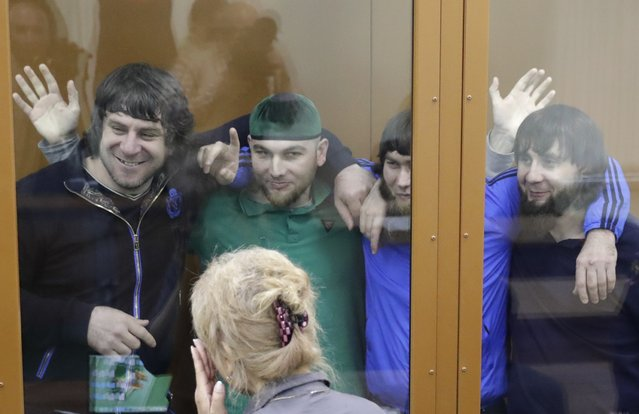 (L-R) Temirlan Eskerkhanov, Shadid Gubashev, Anzor Gubashev and Zaur Dadayev, convicted of involvement in the killing of Russian opposition leader Boris Nemtsov, react inside the defendants' cage during a hearing at the Moscow military district court, Russia July 12, 2017. (Photo by Tatyana Makeyeva/Reuters)